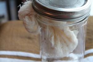 Yogurt draining in a jar